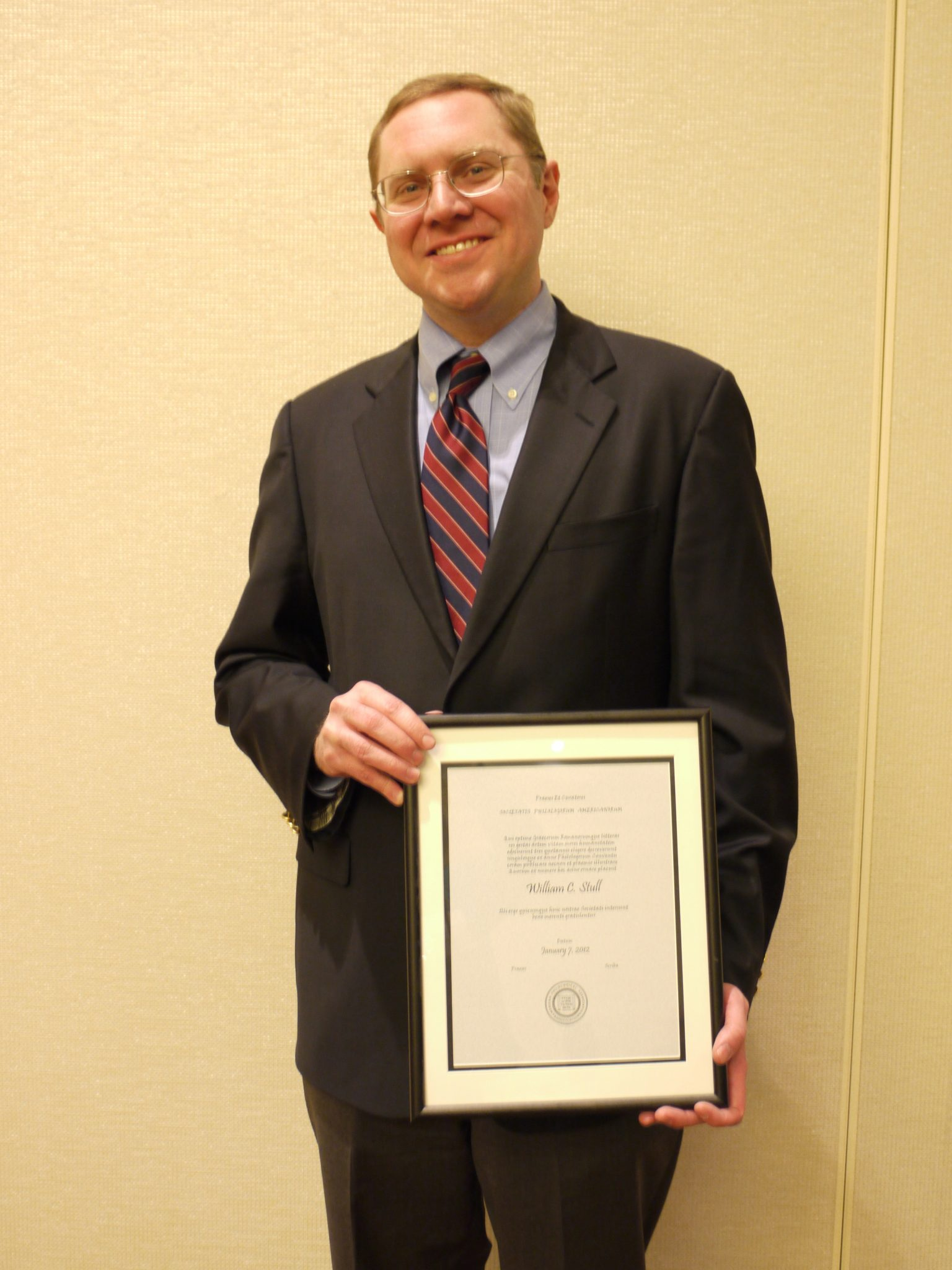 <p>Photo of Professor William Stull receiving the</p><p>Teaching Award from the</p><p>American Philological Association. January 2012.</p>
