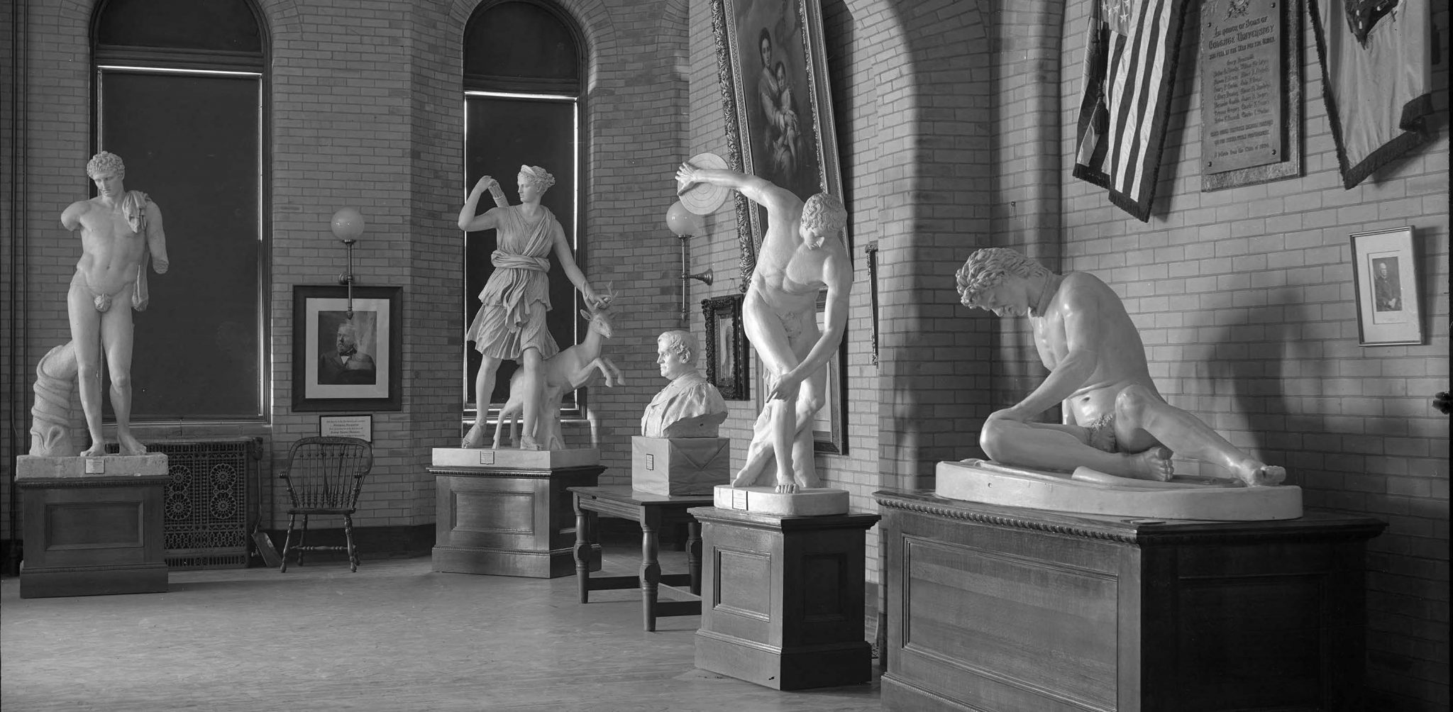 <p>Northeast corner, first floor of library with statues, including Civil War Memorial, 1904. Photo by Edward H. Stone.</p><p>Edward H. Stone Collection. Special Collections and University Archives, Colgate University Libraries.</p>