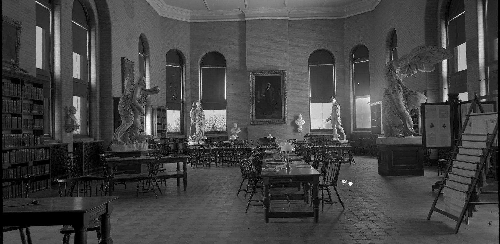 <p>West end of reading room in library with winged statue, 1904. Photo by Edward H. Stone.</p><p>Edward H. Stone Collection. Special Collections and University Archives, Colgate University Libraries.</p>